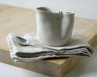 Folded pouring jug for milk - hand thrown in stoneware and glazed in vanilla cream