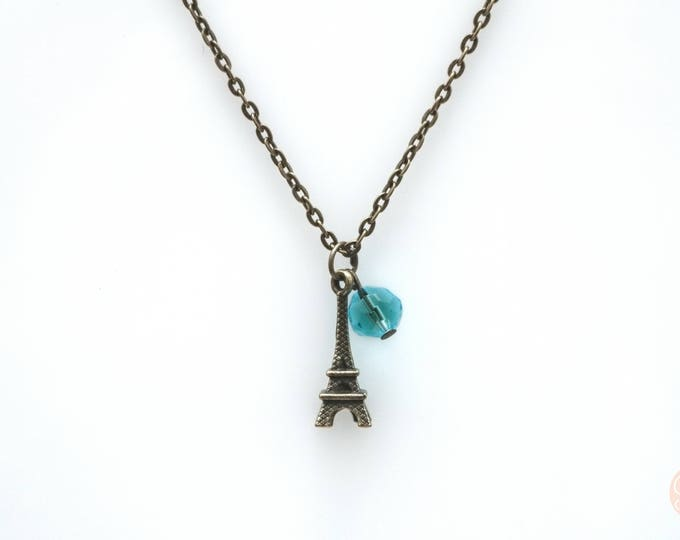 Eiffel tower necklace with blue feature bead.