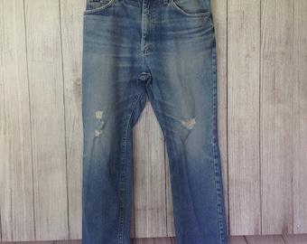 Vintage Rustler Distressed and Worn Mens Blue Denim Jeans