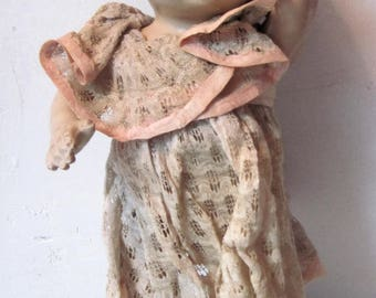 Antique Vintage composition baby Doll with delicate lace dress