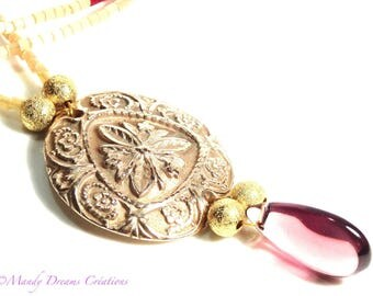 Creative necklace with refined motifs, antique, baroque, artisan creation in gilded bronze paste