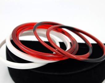 Stack of Lucite Spacer Bangles in Red and White, ca. 1960s
