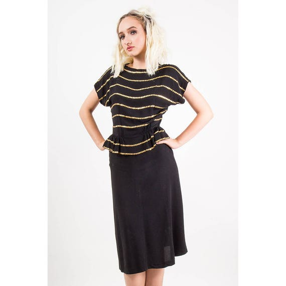 Black peplum dress with studs