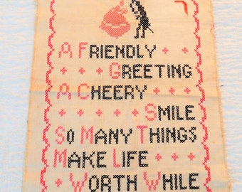 Vintage Cross-Stitch Motto Sampler..A Friendly Greeting, A Cheery Smile...