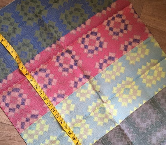 "Two pieces of one-off woven silk fabric sample lengths in a mix of colours both measuring 23"" x 36"" in a medium weight"