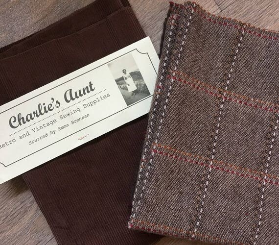 Two half yard double width pieces of toning British fabric - one windowpane check wool tweed and one top quality corduroy in shades of brown