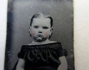 antique miniature gem tintype photo - 1800s, little girl with pouty face, chubby cheeks, off the shoulders dress
