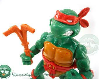 Vintage TMNT Action Figure: Michelangelo with Storage Shell 1990s