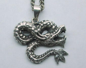 Sterling dragon necklace marked 925 with tooth