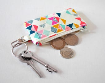 Women's triangle flag change pouch key chain fob coin padded gadget purse in mustard yellow, pink and navy blue print.