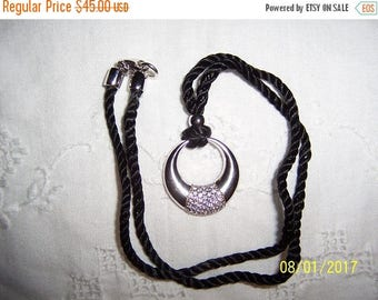 TWICE A YEAR, 25% Off Vintage Clear Cubic zirconias round pendant with black cord. Sterling silver.