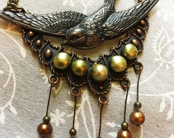 SALE...56.00-10%= 50.40 ... Xena's Prey...Copper and Soaring Antiqued Bronze Bluebird Pendant Necklace With Gold Pearls & Antiqued Brass