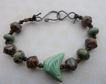 handmade ceramic green bird lampwork bracelet, uk copper jewellery