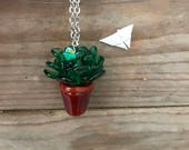 green succulent with a tiny flower handblown by me glass pendant