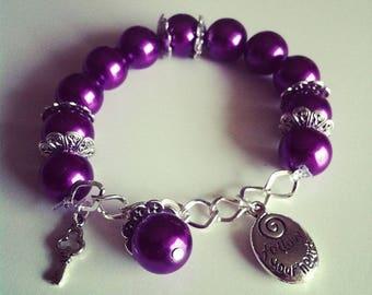 #53 purple charm bracelet