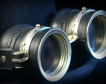 Steampunk goggles in black leather and brass.