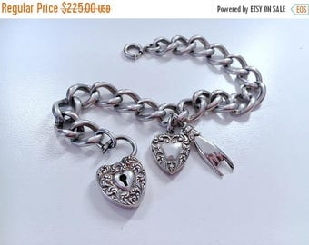 BDAY BONANZA SALE Antique Victorian repousse heart padlock bracelet with puffy heart and Mano Cornuto charms Sterling Silver
