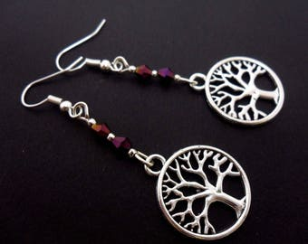 A pair of pretty tree of life purple  crystal  dangly earrings.