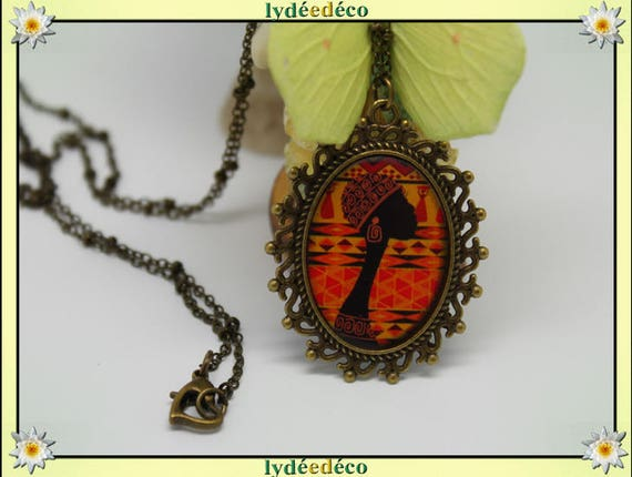 Necklace, retro vintage women in African ethnic orange brown black Medallion retro resin and brass Locket 18 x 25mm