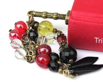 """Bronze sword-shaped bookmark embellished with glass beads in different colors: """"The bookmarks of Sam Ouraye"""""""