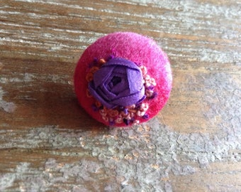 Handmade felted and embroidered button