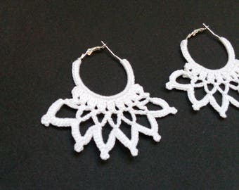 white crocheted earrings in the form of rings
