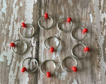Knitting snagless stitch markers using red glass seed beads