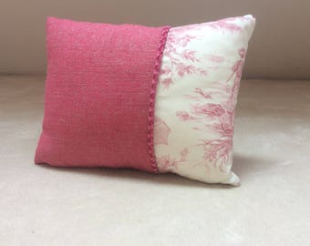 Pink cushion and toile
