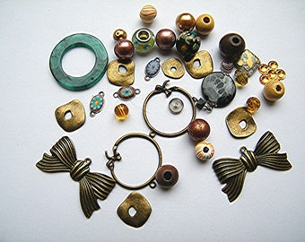 Beads, bronze metal, glass, wood, acrylic, 35 beads