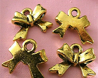 Brass bow charms, dimensions: 15 x 10 mm sold per 5