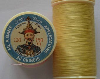 Spool of thread color 335 puppet