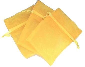 gold tone button organza pouch size 9 x 7 cm