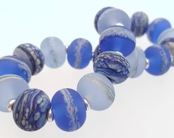 Stretch Bracelet using my handmade marbled blue glass beads