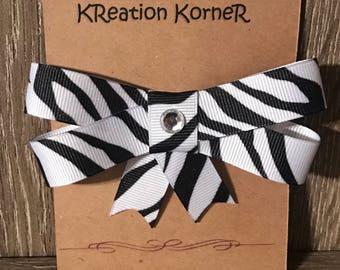 Black and white zebra print bow