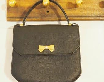 Vintage Nina Ricci little black handbag