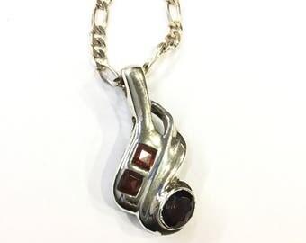 Silver garnet pendant on chain