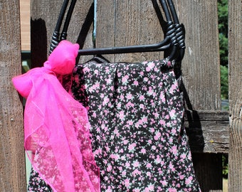 Handmade bag. With vintage handles/fabric. Plastic handles/floral/pink/black/checkered/fabric/ Reversible bag. Purse/tote! With pink scarf.