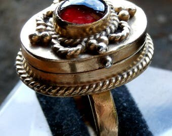 Sold Sandra 3. 23/09 Antique Georgian Gilt Decorated Poison Ring with Blood Red Pyrope Garnet Set Cased En-Cabochon Circa: 1780 – 1820 (K)