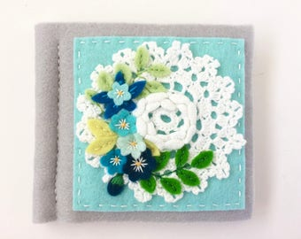 blue and grey vintage style needle book with pretty blue felt flowers and hand embroidery