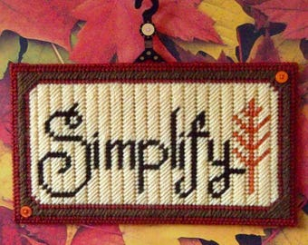 """Plastic Canvas: """"Simplify"""" Wall Hanging (plastic wall hanger attached)"""