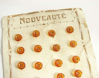 24 tiny glass buttons in orange colour, small orange buttons on a button card, antique 1930s buttons