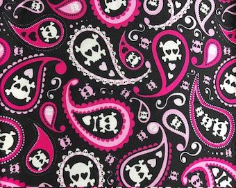 Skulls and bones in pink swirls