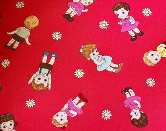 Dolls in red cotton fabric.  Quilt Gate.  LW1960-11.  Printed in Japan.