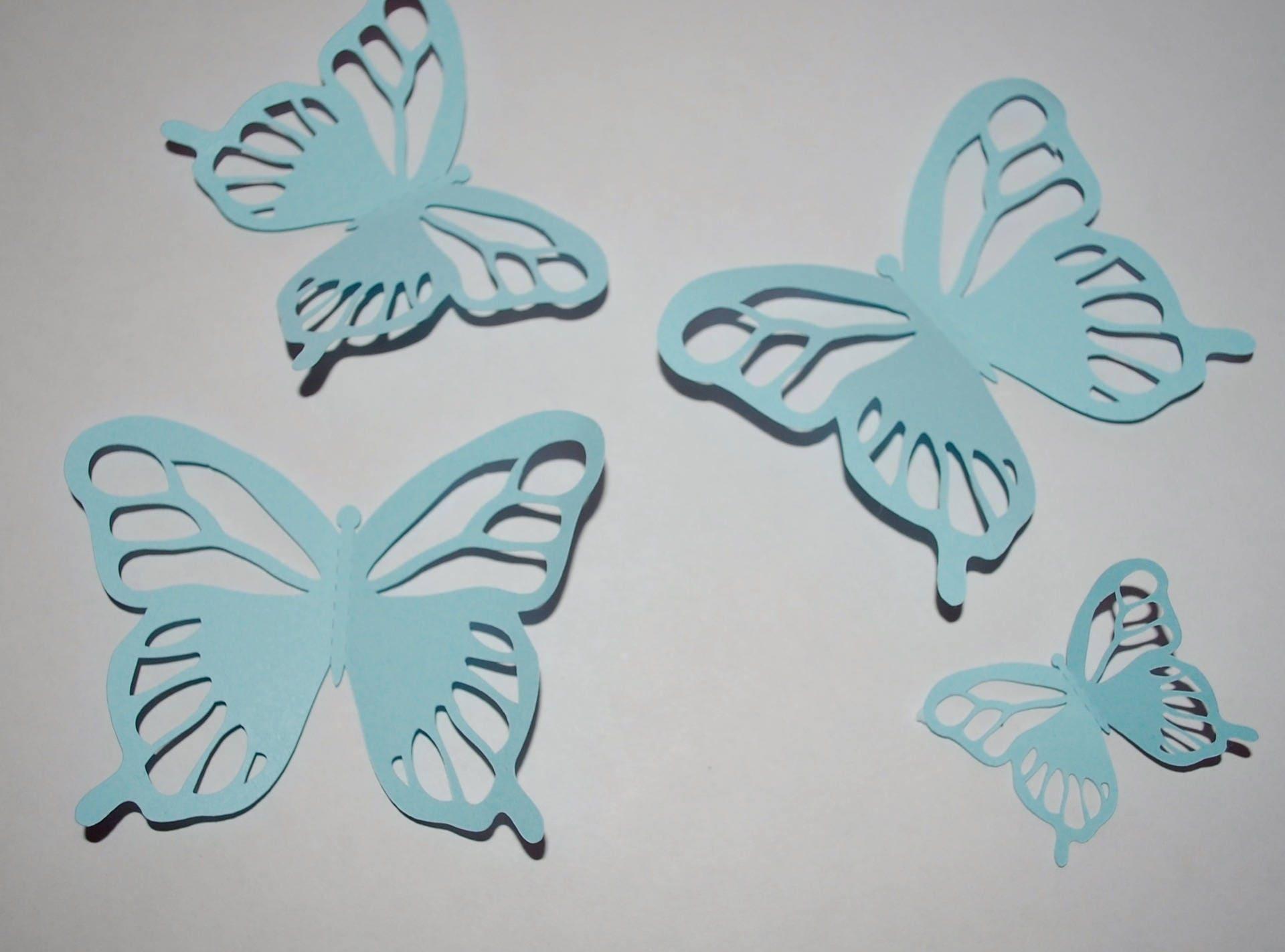 4 papillons en papier bleu pour décoration murale en 3D