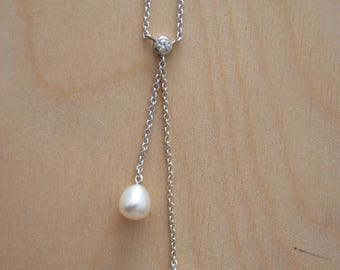 Silver Necklace with cubic zirconia and pearl.