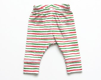 Baby leggings with red and green stripes. Comfy toddler pants. White knit fabric with stripes. Infant cuff leggings.