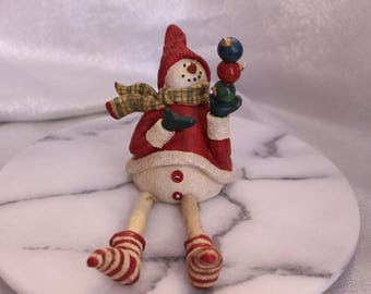 Vintage Collectible Snowman holding ornaments and dangling legs Christmas Decoration