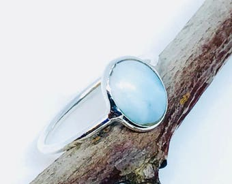 Larimar ring set in sterling silver (92.5). Size- 5, 6, 7, 7 3/4. Natural authentic larimar stone .
