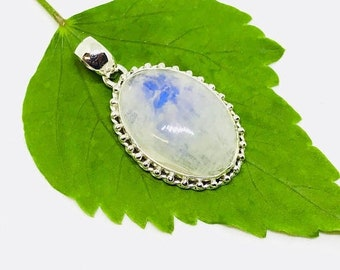 10% Rainbow Moonstone Pendant/ necklaces set in Sterling silver 925. Natural authentic moonstone. Length - 1.71 inch long. Open back.