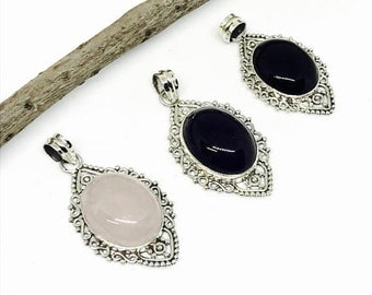 10% Amethyst, Rosequartz, Blackonyx pendant set in sterling silver (92.5). Natural authentic stones. Length-1.79 inch.